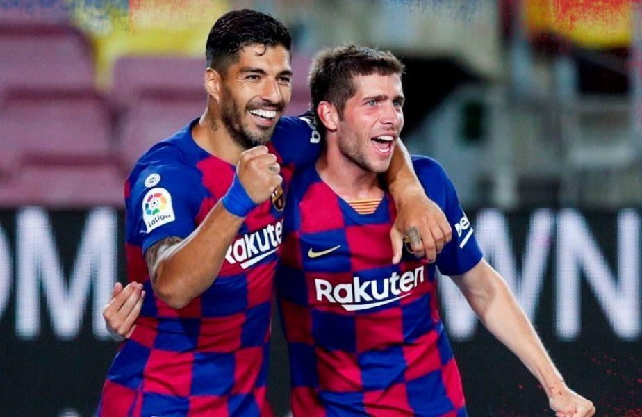 Barcelona a trimis-o pe rivala Espanyol direct în liga a doua după un meci cu două eliminări. Luis Suarez a înscris golul prin care Barça încă mai speră la titlu