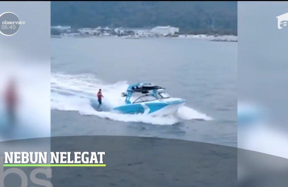 Să te dai cu placă de surf fără să fii legat de barcă cu motor. Asta este cascadoria momentului